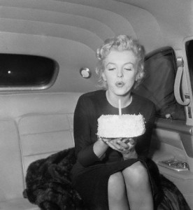 01 Jun 1956 --- Marilyn Monroe Blowing Out Candle on 30th Birthday Cake --- Image by © Bettmann/CORBIS